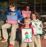 Clockwise:  Ethan Campbell, Teagan Koch, Wyatt Hoffer and Cohen Moseley hold their winning art work.