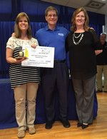 Mrs. Black receiving the Golden Apple Award