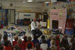 Mr. Powell, our Principal, reads to a kindergarten class