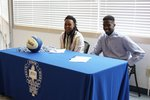 MHS student athletes Tariah Mouton (left) and Don'Taidrae Scott (right) committed to play college basketball in a signing ceremony on Tuesday, April 12.