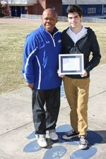 MHS Principal Victor Hubbard (left) and National Merit Finalist John Thomas Goldman (right)