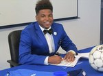 Meridian High School center midfielder Kelvin Mauriscey is pictured Wednesday morning at the school signing to continue his soccer career at Copiah-Lincoln Community College.