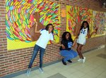 National Honor Society Students proudly display the turkey feathers sold.