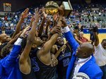 Meridian celebrates winning the 6A state championship boys` basketball game on Saturday in the Mississippi Coliseum. The Wildcats beat Murrah 68-59. Photo: Bob Smith, For The Clarion-Ledger