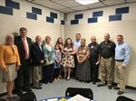 Simpson is pictured with family, Mr. Jarnagin, members of the Grainger County School Board.