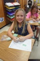 Caroline Jones is using her dough to form mountains on her physical map.