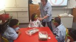 Mrs. Martin in the Science lab with Mrs. Marshall's students.