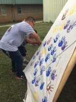 Sunset students add handprints to  Community teepee project