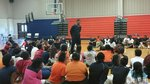 Senior basketball player Cedric Essex shares with 6th graders