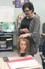 Helton demonstrates an A-Line Bob Haircut.