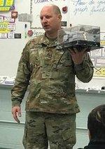 Sgt. George shows a $20,000 sign-on bonus visual.