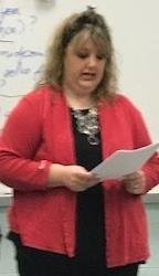 Mrs. Price explains insurance laws to Pathways` students.