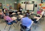 Ms. Elena Puckett explains the life skills activity to Pathways` teachers.