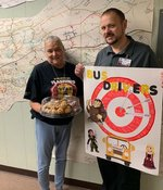 Hawkins County School Transportation Assistant Ree Quarles accepts a thank you basket and notes for bus drivers from Pathways Alternative School Data Clerk Mr. Brian Laster.