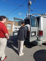 PAS students help unload a delivery truck.