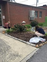 An agriculture student works in the landscaping at PAS