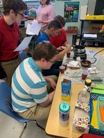 PAS science students connect diffusion and chemical reactions to heat energy while making sassafras tea and catnip tea.