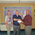 Johnny Hand delivers donation check to Principal Crutchfield and Counselor Laura Ore