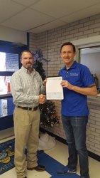Rodney Blake of McGraw Oil/Kwik Chek presents Principal Brent Fitzgerald the ExxonMobil Educational Alliance Grant