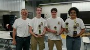 Members of theOHS Chess Club poses with Team and 1-2-3 trophies.