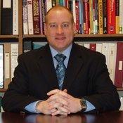 Dr. David A. Rust, Director