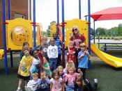 Ms. Thomason and First Class Pre-K students enjoy outdoor activities.
