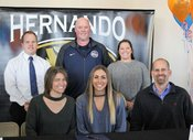 Hernando High School volleyball standout Kaitlyn Doyle has signed a scholarship offer to play at Wallace State (Ala.) Community College next year. Seated from left are mother Christine Doyle, Kaitlyn Doyle and father Russell Doyle. Standing from left are assistant principal Caleb Shephard, Wallace State coach Randy Daniel and Hernando head coach Jayme Vinson. Bob Bakken|DTT