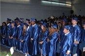 Graduates listen to Mr. Cox, Principal of WISE, at graduation