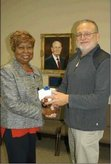 "Lanett Board of Education Chair Gwen Harris-Brooks, left, presents Lanett High social studies teacher Wayne ""Chip"" Seagle a gift on behalf of the board. Seagle is retiring from the classroom at the end of this month"