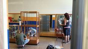 Parents, Mrs. Angela Davis and Mrs. Karen Shanks work to clean the trophy cabinets and restore them to their original place.